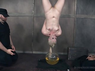 Mature submisive slut Dresden forced to pee almost a bucket before abuse