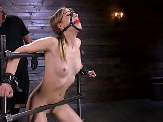 Affianced porn model Kristen Scott gets her pussy toying in the dark BDSM room