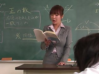 Lecturer helps a well-draped schoolgirl to concentrate on the homework