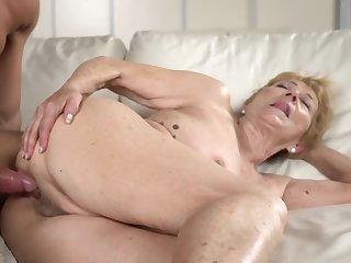 A grotesque old granny gets a hard unearth between her legs on the sofa