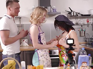 Two cooking girls in aprons swallow a broad in the beam Hawkshaw covered in whipped cream and get fucked