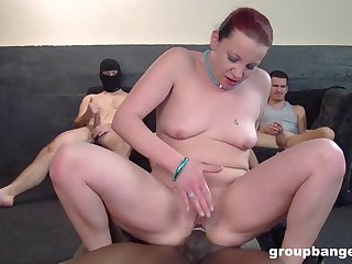 Gangbang on the floor with time again be fitting of guys and a redhead babe